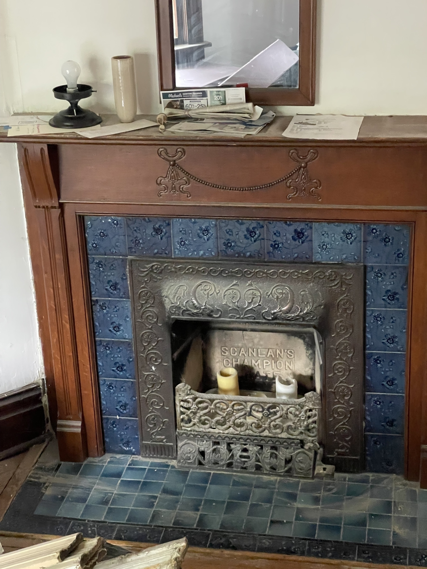 The tile! The carving in the lintel! The metalwork on the firebox! So much to love here.